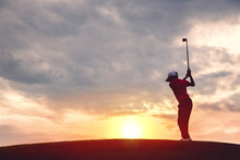Silhouette Of Boy Golfer With Golf Club At Sunset