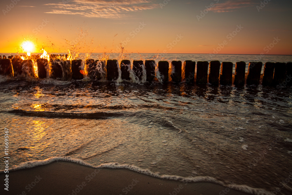 Fototapety, obrazy: Sunset at Baltic sea, view on old breakwater piles.