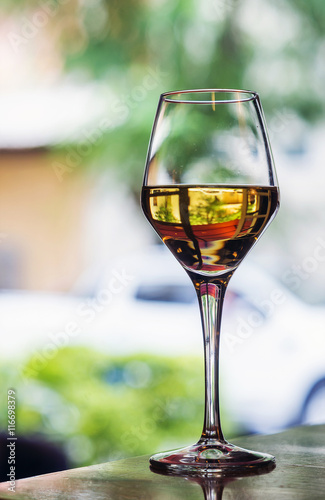 glass of spanish jerez sweet sherry wine in outdoor cafe Wallpaper Mural