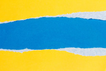 Torn Yellow Paper With A Blue ...