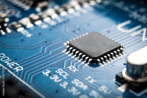 Valokuva  Integrated semiconductor microchip/ microprocessor on blue circuit board represe