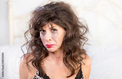 Valokuva  Upset Woman Crying in Bedroom