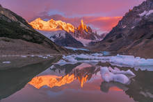 Scenic View Of River With Snow Covered Mountain During Sunset