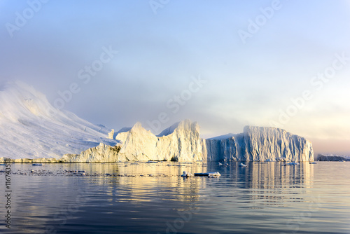 Poster Glaciers Icebergs are on the arctic ocean on sunset time with shadow
