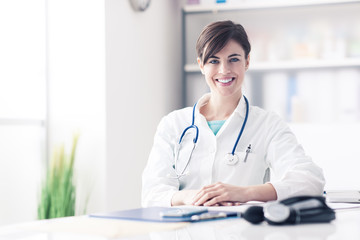 Doctor working at office desk