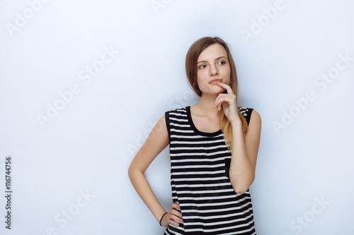 Portrait of happy young beautiful woman in striped shirt touching her lips posin Fototapet