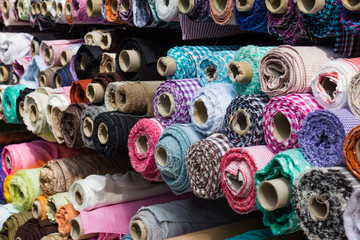 fabric rolls at market stall ,  textile industry background