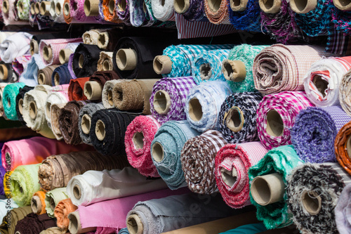 Foto op Aluminium Stof fabric rolls at market stall , textile industry background