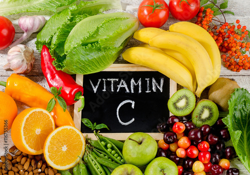 Foods High in vitamin C on wooden board. Healthy eating.