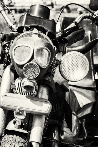 Detail of veteran motorbike with symbolic gas mask, colorless
