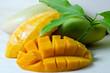 Sliced ripe yellow mango with leaf