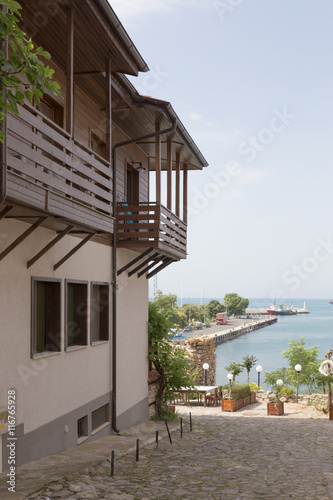 City on the water NESSEBAR, BULGARIA, JUNY 18, 2016: The streets of the old city resort of Nessebar in Bulgaria are full of tourist during summer. Old town is famous for its distinctive wooden architecture