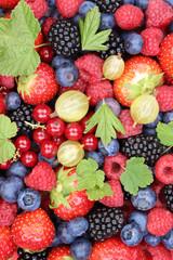 Beeren frische Früchte Erdbeeren Himbeeren Blaubeeren Hintergru