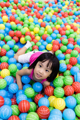 Fototapeta na wymiar Asian Little Chinese Girl Playing with Colorful Plastic Balls
