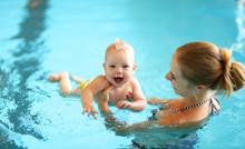 Mother Teaching Baby Swimming Pool