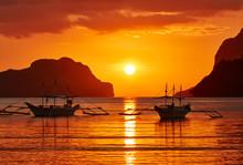 Traditional Filippino Boats At El Nido Bay In Sunset Lights. Palawan