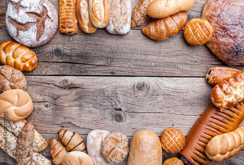 Valokuva  Delicious fresh bread on wooden background