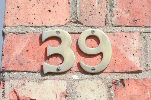 Poster House number 39 sign on wall