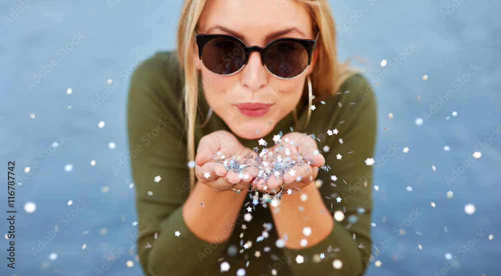 Fototapety, obrazy: Attractive young woman blowing glitters