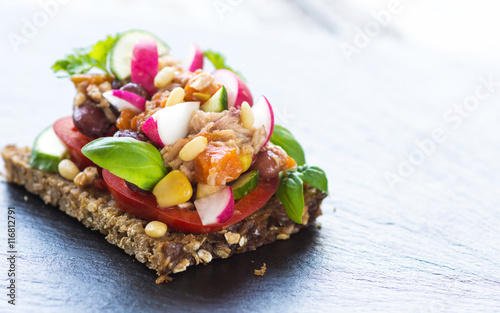 Spoed Foto op Canvas Voorgerecht Delicious sandwich with tuna and fresh crunchy vegetables