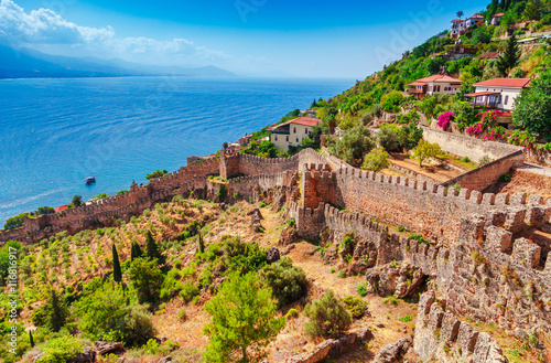 Foto auf Leinwand Lachs Beautiful sea panorama landscape of Alanya Castle in Antalya district, Turkey, Asia. Famous tourist destination with high mountains. Summer bright day and sea shore
