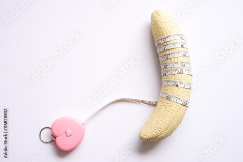 Fotografia, Obraz  banana with measurement tape men penis size concept