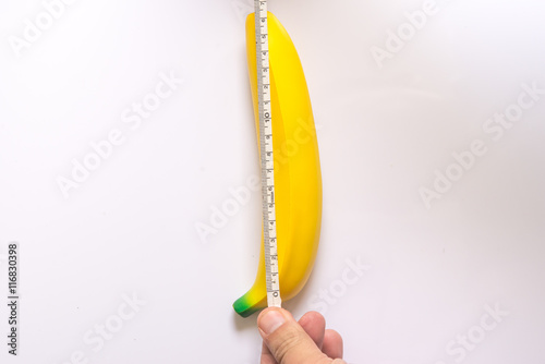Valokuvatapetti banana with measurement tape men penis size concept