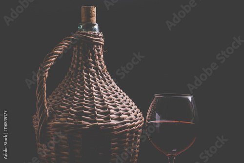 Fototapeta wine carboy and wine glass