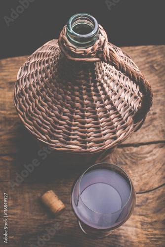 Valokuva wine carboy and wine glass