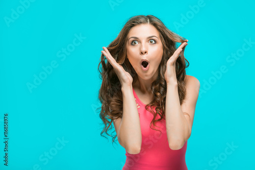 Portrait of young woman with shocked facial expression Wallpaper Mural