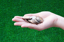 Coins In Hands On Grass,Donation Investment Fund Financial Support Charity  Dividend Market Growth Home House Stock Trust Wealthy Giving Planned Accounting Collection Debt Banking ROI Concept