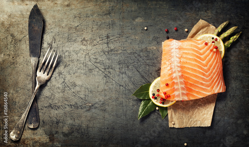 Photo  Raw salmon fillet and ingredients for cooking