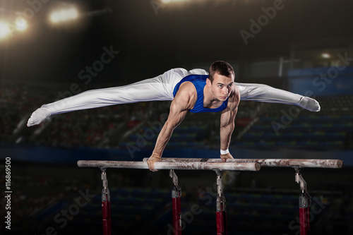 Spoed Foto op Canvas Gymnastiek portrait of young man gymnasts