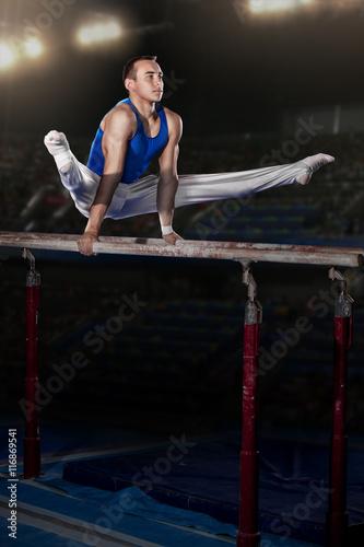 Foto op Canvas Gymnastiek portrait of young man gymnasts