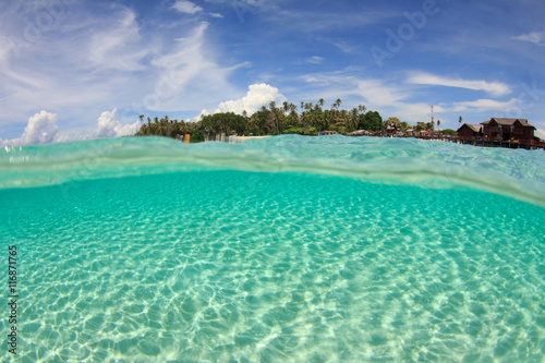 Foto op Plexiglas Eiland Tropical island and ocean split image half and half over under