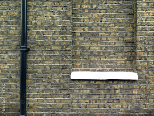 Photo  London Bricked Window / Background wall with windows bricked up and gutter