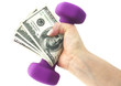 canvas print picture - Fiscally fit—holding cash with dumbbells.