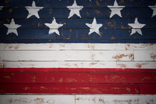 United States Flag Painted On Wooden Planks Forming A Background
