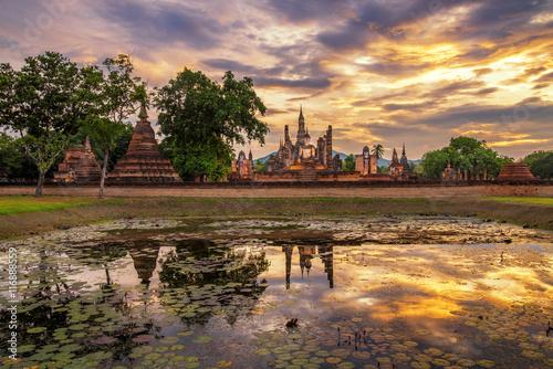 Fotografie, Obraz  Sunset scene at sukhothai historical park Thailand with reflecti