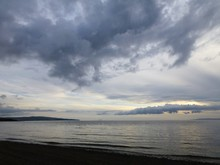 Sunset Over The Firth Of Clyde From Prestwick Beach, Ayrshire, Scotland With Varied Cloud Formations