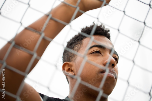 Valokuva Young African American Teenager in deep thought looking concerned