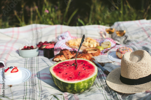 Keuken foto achterwand Picknick summer picnic on the rug. Fruits, berries, pastries and cheese