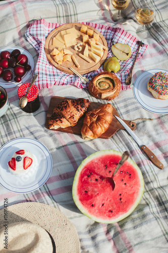Foto op Aluminium Picknick summer picnic on the rug. Fruits, berries, pastries and cheese