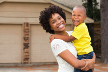 African American Mom And Her Son.