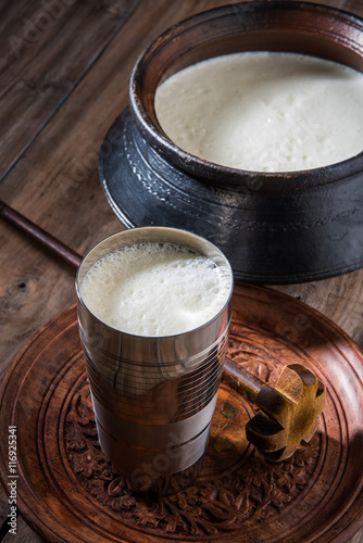 Valokuva  Indian sweet Lassi made up of milk, curd, sugar and salt mixed with ice cubes, s