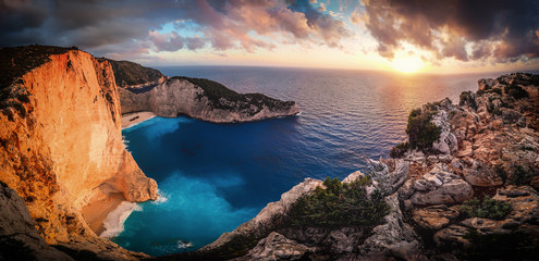 Sunset at Navagio Bay Zakynthos Greece. Panoramic view over the