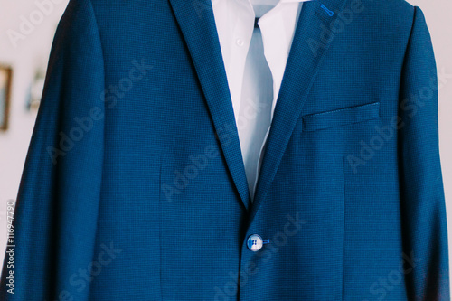 Fototapety, obrazy: Close-up of expensious blue suit hanging indoors