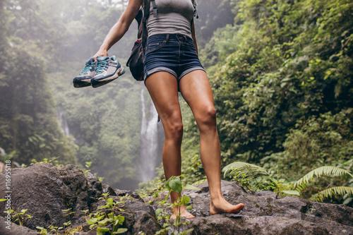 Cuadros en Lienzo Woman hiking barefoot on forest trail