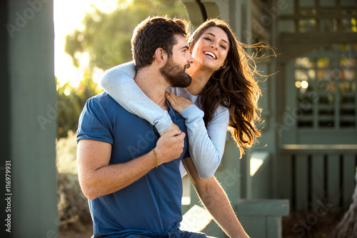 Elated couple lovers joyful bliss joy fun laughing playing youthful Fototapeta