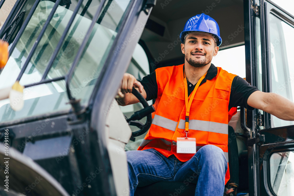Fototapeta Skid steer loader operator